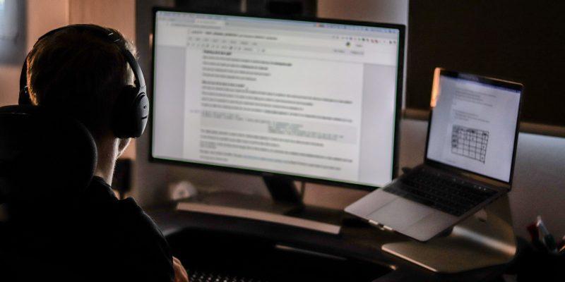 Guy writing code