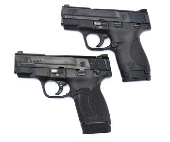 Two Smith and Wesson Shield pistols, left profile