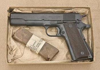 Colt 1911 pistol with wrapped magazine