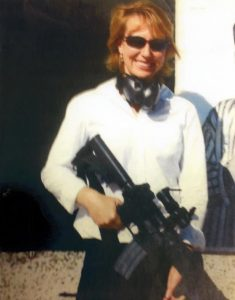 Gabrielle Giffords posing with an AR-15 rifle.