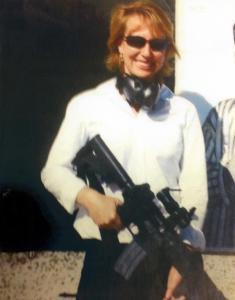 Gabrielle Giffords posing with an AR-15 rifle.