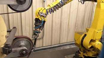 Robotic arm precision grinding a gun barrel