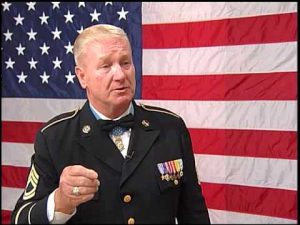 Sammy Lee Davis with congressional medal of honor