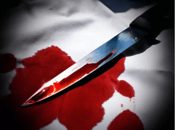 Bloody knife on a blood stained white towel