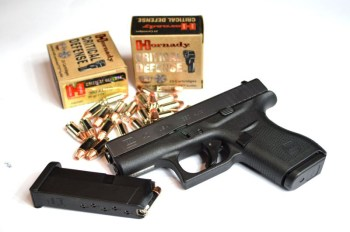 Glock G42 with two boxes of Hornady Critical Defense