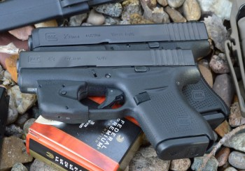 Glock G29 over a Glock 43 showing the length difference
