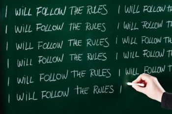 Writing follow the rules on the chalkboard