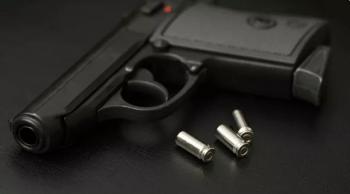 Pistol with three empty casings