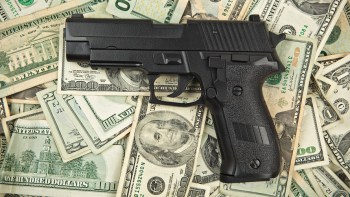 SIG Sauer pistol on 100 dollar bills