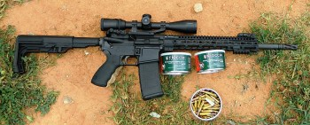 AR_15 with two cans of Fiocchi ammunition