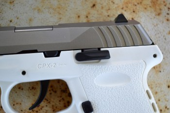 Slide stop on a white SCCY CPX-2 pistol