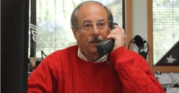 Alan Gottlieb talking on the phone at his desk