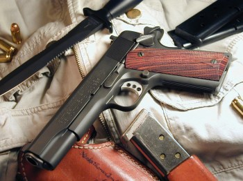 A Colt 1911 pistol cocked and locked.