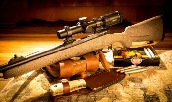 bolt action rifle with Riton dangerous game rifle scope and hunting knife