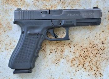 Used Glock 22 pistol left profile