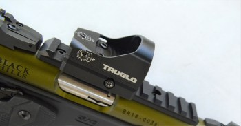 Tru-Tek red dot sight mounted on a Picatinny rail