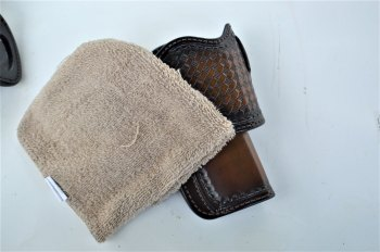 brown leather holster with cleaning cloth