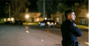 armed good guys Police officer guarding crime scene