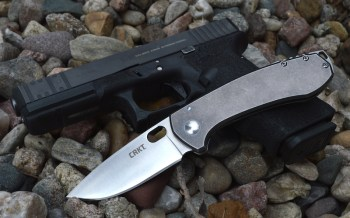 CRKT Amicus knife over a Glock pistol