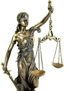 Blindfolded lady holding the scales of justice