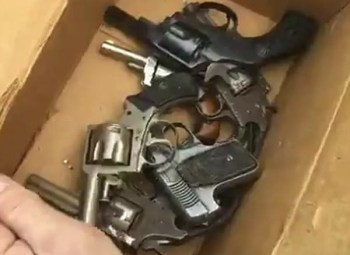 Box of old pistols and revolvers for gun buybacks