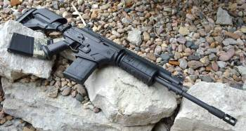 Galil ACE .308 right profile on a bed of rocks