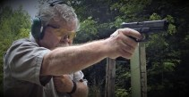 Bob Campbell shooting a pistol one-handed