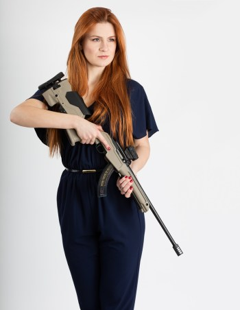 Woman holding a Ruger 10/22 with an Archangel stock