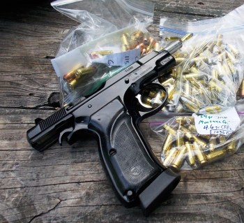 9mm pistol on a ziplock bag with handloads