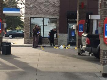 Evidence markers littering the scene of a shooting
