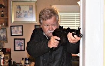 Bob Campbell shooting an AK-47 pistol from a braced position