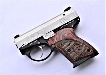 Bond Arms Bullpup pistol with wood grips left profile