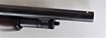 Front bead sight on a shotgun barrel