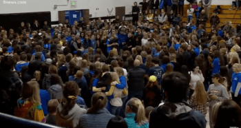 Students and parents at a vigil for school shooting victims