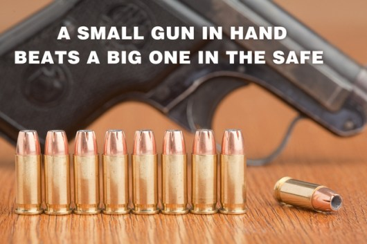 Small Caliber handgun on a table with several rounds of loose ammunition to dispel gun myths