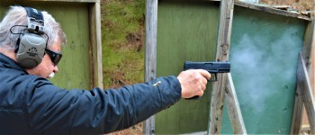 Bob Campbell shooting the taurus TX22 pistol with a one-handed grip