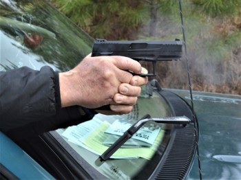 Bob Campbell shooting the Taurus TX22 pistol with a two-handed grip