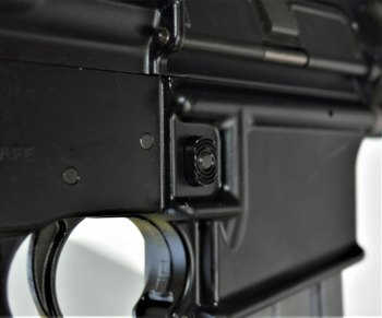 Magazine release on the Colt AR-15 rifle