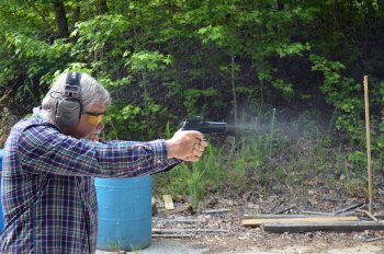 Bob Campbell shooting a pistol fitted with an optical sight demonstrating speed and accuracy