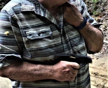 Man firing a pistol from the hip