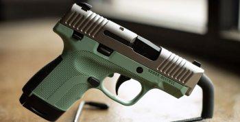 Sea foam green Honor Defense pistol