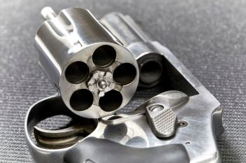 Revolver with open cylinder ready for armed good guys