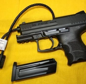 Pistol with magazine removed and a gun lock inserted through the barrel showing the shortcomings of red flag laws
