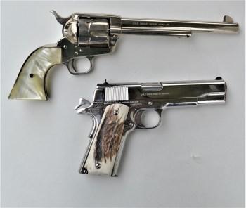 Old Colt revolver and Colt 1911 pistol