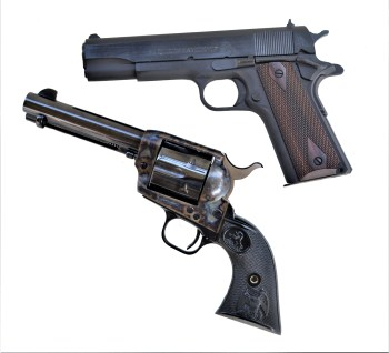 1911 .45 ACP pistol and .45 Long Colt revolver below