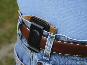 HOlster without reinforcements showing how it collapses under the pressure of a belt