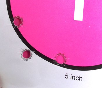 Bullet holes in a pink circle target