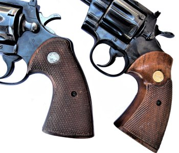 two Colt Python revolvers showing early versus later model grips