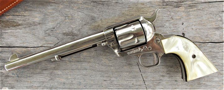 Colt Single Action Army left profile on a wood background