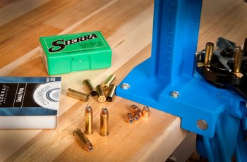reloading press with a box of Sierra bullets ready for reloading